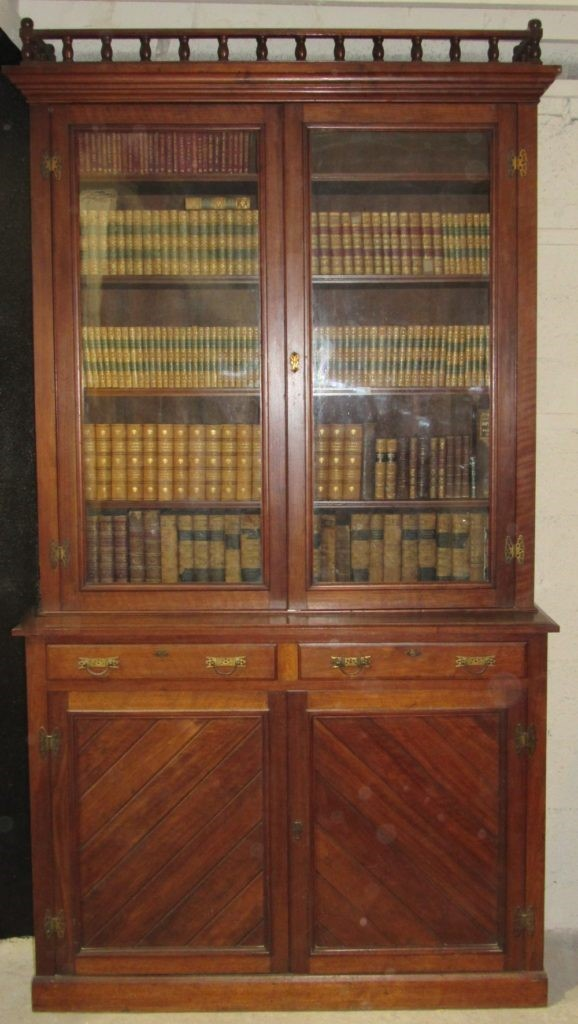 Lot 15 - A late 19th Century tall Irish oak Bookcase, possibly by Strahan, Dublin,