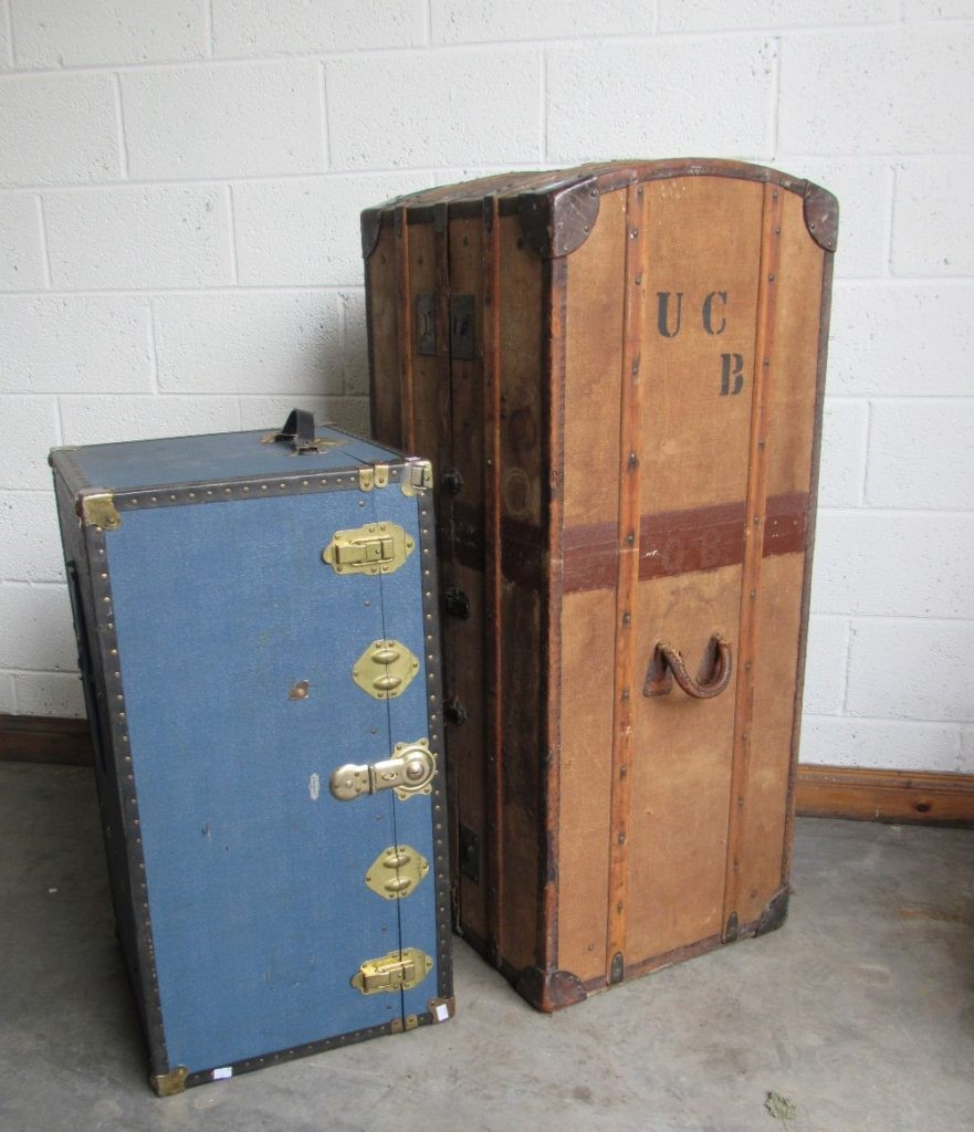 Lot 19 - A late 19th Century tall leather bound canvas Trunk Wardrobe,