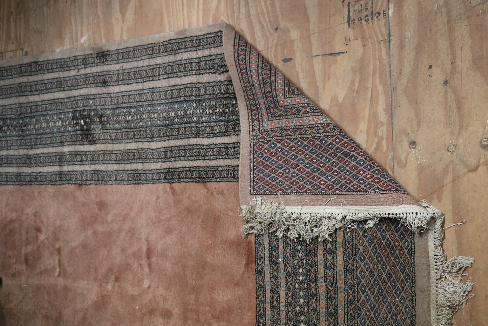 Lot 5 - An Oriental fawn ground central panelled Carpet, with multiple borders.