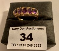 9k gold ring with purple stones, w: 3.78 grams, size O