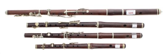 Three old rosewood and nickel mounted flutes, one stamped Hy. Potter & Co, London; also an old fife,