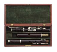 Old rosewood flute by and stamped Haynes, Kaloton, with eight nickel keys on wooden blocks, mahogany