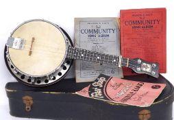 Interesting old ukulele banjo with rectangular trademark metal plate to the head inscribed Harold