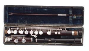 Composite rosewood flute by and stamped Rudall Carte & Co, 23 Berners Street, Oxford Street, London,