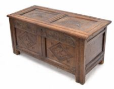 Charles I oak coffer, the double panelled top with unusual semicircular fan shaped fluted carved