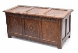 18th century oak carved panelled coffer, the triple panelled moulded top enclosing open interior,