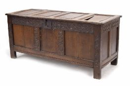 Part-Charles I oak coffer, the quadruple raised panelled top with moulded edge opening to reveal a