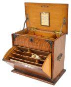 Edwardian oak brass mounted mahogany stationery box, the hinge lid and fall front enclosing a