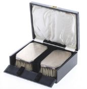 Art Deco cased pair of silver engine turned brushes, maker John Rose, Birmingham 1936, monogrammed