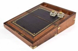 Victorian walnut brass bound writing slope, the fitted interior inset with two square glass ink