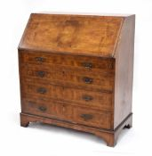 Georgian style walnut bureau, the hinged fall front enclosing fitted secrataire interior, over