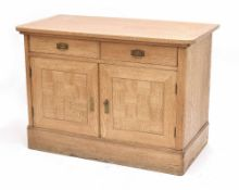 Pine cupboard with parquetry panelled doors, the shaped top over two short drawer and two cupboard
