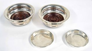 Pair of P H Vogel & Co. silver wine coasters, with turned hardwood bases on green baize,