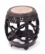 Good Chinese hardwood barrel shaped side table, the pink marble top within a continuous band of