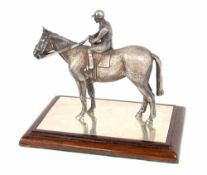 Wakely & Wheeler good quality cast silver horse and rider model, London 1994, upon a rectangle