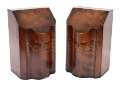 Pair of Georgian mahogany serpentine knife boxes, the hinged lids enclosing a fitted interior and