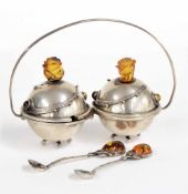 Polish Art Nouveau cruet set on stand, the covers with stylized amber rose flower heads, the two