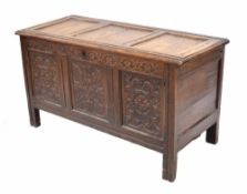Late 17th century English carved oak coffer, the triple panelled top opening to reveal a later lined