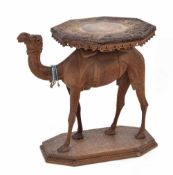 Eastern 19th century novelty carved hardwood camel side table, the octagonal top carved with dragons