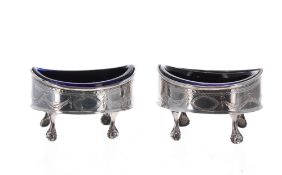 Pair of George III silver oval salts with blue glass liners, with engraved swag decoration around