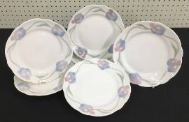 Set of six vintage Rorstrand Sweden ceramic side plates, with raised moulded floral decoration to