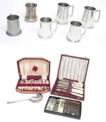 """Five pewter tankards, each with golfing related presentation inscription, tallest 9"""" high;"""