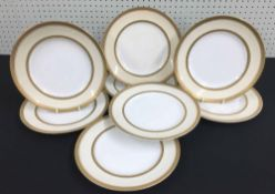 """Set of eight Booths for T Goode & Co. china plates, decorated with arching gilt rim borders, 9.5"""""""