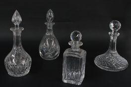 "Four glass decanters including a ship's decanter, 10"" high including stoper (4)"