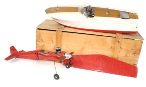 """Fibreglass scale model pond motor boat, 31"""" long, (af) stand and crate; together with a partially"""