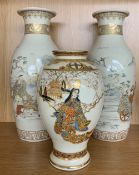 """Pair of Japanese Satsuma vases decorated with figures in landscapes, impressed seal mark, 13.5"""" high"""