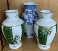 """Japanese blue and white porcelain ovoid vase decorated with blossoming branches, 12"""" high;"""