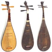 Three Chinese pipa lutes all in need of attention