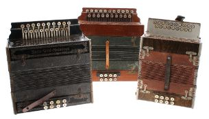 Three melodeons in various conditions, including a Saxa-Gold-Melodeon, a Meinel & Herold and one