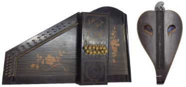 19th century rosewood heart shaped fretted table zither labelled Hart & Son, 14 Princes Street,
