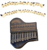 Selection of spare organ stops; together with an interesting ten keyed glockenspiel in the form of a