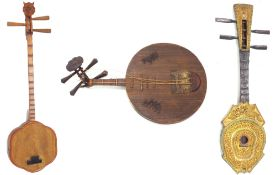 Decorative Thai Sueng lute; together with a Chinese yueqin moon lute and another Chinese lute (3)