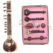 Miniature Indian sitar; together with a boxed set of miniature Indian musical instruments (2)