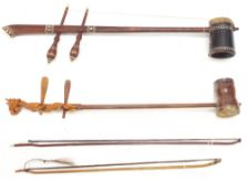 Two Chinese two string erhu fiddles with two associated bows