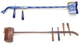 Decorative Chinese blue and white two string erhu fiddle; together with a similar four string fiddle