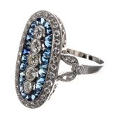 Attractive platinum diamond and sapphire ring set with five vertical graduated diamonds,
