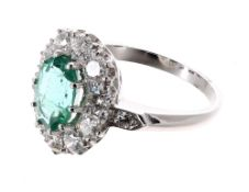 Good platinum emerald and diamond oval cluster ring, the emerald estimated 2.00ct, with a surround