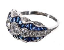 Fine quality platinum sapphire and diamond dress ring, with three principle round diamonds in a