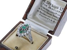 18ct white gold emerald and diamond marquise cluster ring, with three central round emeralds in a