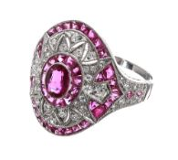 Ornate platinum ruby and diamond oval cocktail ring, set with oval ruby surrounded by a halo of