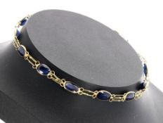 14k yellow gold sapphire bracelet, set with twelve oval sapphires, estimated 0.35ct approx, 2.2gm,