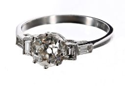 Art Deco style platinum diamond ring, set with an old-cut diamond with diamond set shoulders, the
