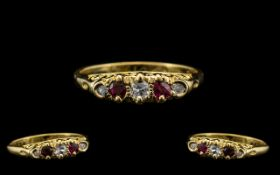Antique Period - Attractive 18ct Gold Five Stone Ruby and Diamond Set Ring - Gallery Setting.