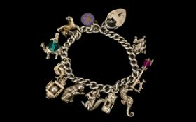 A Vintage Nice Quality Sterling Silver Curb Bracelet loaded with over 12 charms.