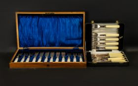 A Box of Twelve Mother of Pearl Handled Fish Knives and Forks, silver ferrules and plated blades.