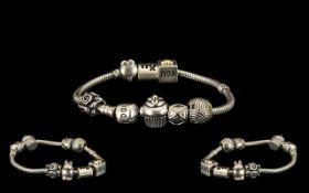 Pandora Bracelet. Pandora bracelet with various charms, please see accompanying image.